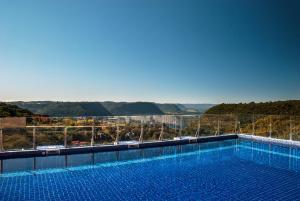 The swimming pool at or close to Master Gramado Hotel - A 1 quadra da Borges de Medeiros