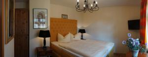 A bed or beds in a room at Hotel Villa Herzog