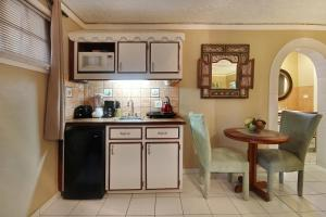 A kitchen or kitchenette at Mary's Boon Beach Plantation Resort & Spa