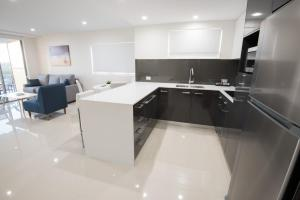 A kitchen or kitchenette at Verve on Cotton Tree