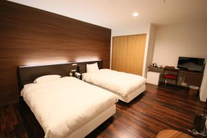 A bed or beds in a room at Furano Shiyuirin