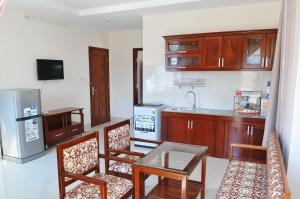 A kitchen or kitchenette at Lotus Apartment Hotel