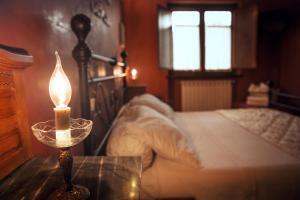 Letto o letti in una camera di Al Vecchio Fontanile B&B
