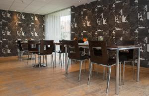 Een restaurant of ander eetgelegenheid bij Hotel Maxim