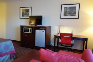 A television and/or entertainment center at Ramada by Wyndham Sacramento