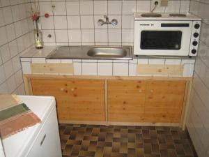 A kitchen or kitchenette at Arbanassi Hotel