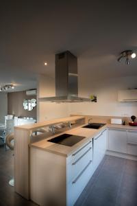 A kitchen or kitchenette at La Villa Farniente
