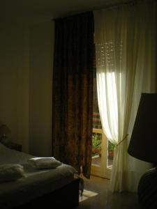 Letto o letti in una camera di Casa Dorotina