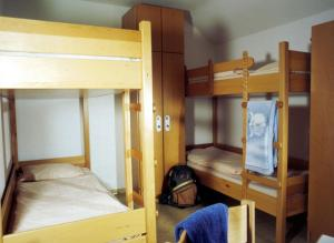 A bunk bed or bunk beds in a room at Jugendherberge Ottobeuren