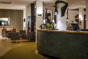 The lobby or reception area at City Hotel Groningen
