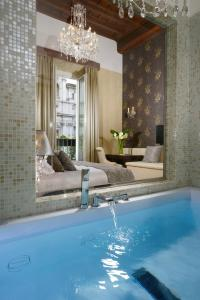 The swimming pool at or near Lifestyle Suites Rome