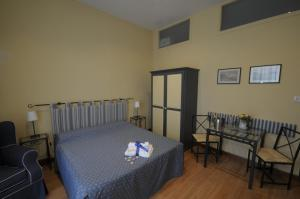 A bed or beds in a room at Monteoliveto Bed & Breakfast