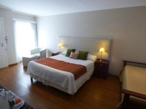 Una cama o camas en una habitación de Villa Nuccia Hotel Boutique