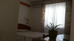 Letto o letti in una camera di Hotel Le Viole