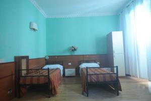 Un ou plusieurs lits dans un hébergement de l'établissement Hostel Beauty