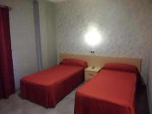 Cama o camas de una habitación en Hostal Virginia