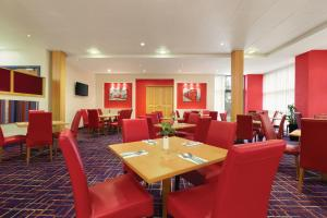 A restaurant or other place to eat at Ramada London North