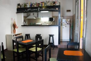 The lounge or bar area at Planet Montevideo Hostel