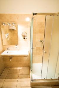 Een badkamer bij Hotel City Bell
