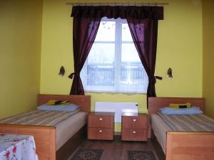 Voodi või voodid majutusasutuse Kagu Hostel toas