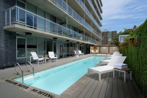 The swimming pool at or near SOHO Residences Lisgar