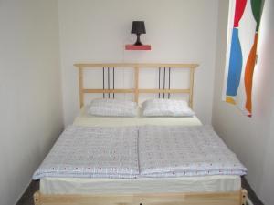 A bed or beds in a room at Hostel Praha Ládví