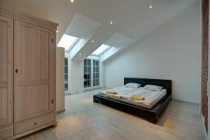 Кровать или кровати в номере СТН Апартаменты у Эрмитажа