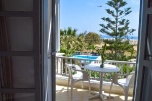 A balcony or terrace at Castro Hotel