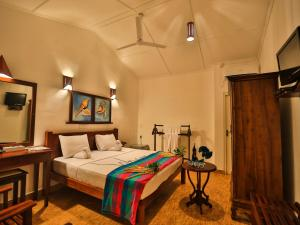 A bed or beds in a room at Thejan Beach Cabanas