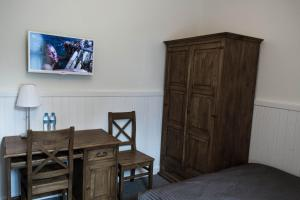 Telewizja i/lub zestaw kina domowego w obiekcie Willa Puławianka