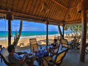 A restaurant or other place to eat at Thejan Beach Cabanas
