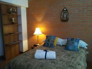 A bed or beds in a room at Mariani International Caracas