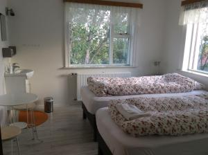 A bed or beds in a room at Guesthouse Kálfafellsstadur