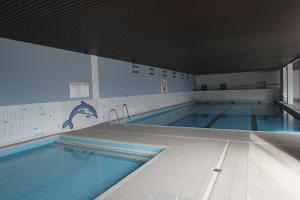 The swimming pool at or close to Appartement sur la digue - De Haan - Le Coq - Silver Beach
