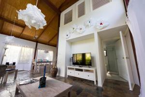 A television and/or entertainment center at Garasu Lodge