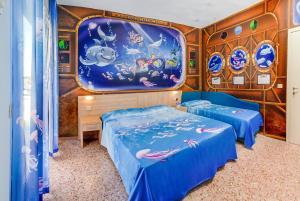 Un ou plusieurs lits dans un hébergement de l'établissement Hotel Bahamas
