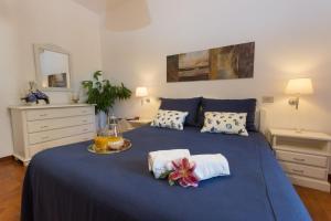 A bed or beds in a room at La Marsa Vacances