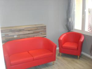 A seating area at Coquelicotel