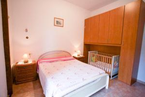 Letto o letti in una camera di Appartamento Villa Vittorio