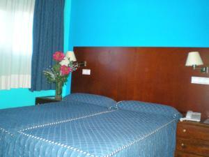 Cama o camas de una habitación en Auto Check In Hotel Las Nieves