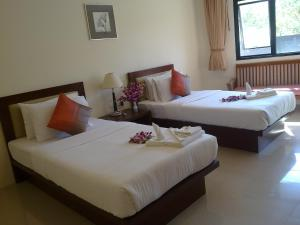A bed or beds in a room at Sea Star House