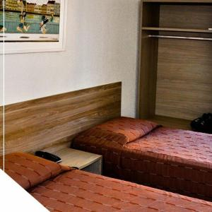 A bed or beds in a room at Hotel Julieta