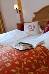 Ein Bett oder Betten in einem Zimmer der Unterkunft Auberge Du Mehrbachel
