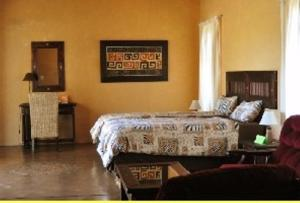 A bed or beds in a room at Kashana Namibia