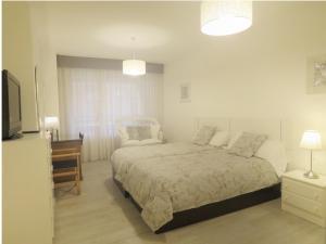 Cama o camas de una habitación en Pension Mayte