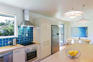 A kitchen or kitchenette at Mi Casa
