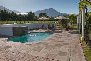 The swimming pool at or near La Galiniere Guest Cottages