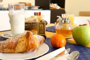 Opțiuni de mic dejun disponibile oaspeților de la Hotel Loreto