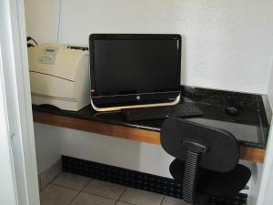 A television and/or entertainment center at Super 8 by Wyndham Dumas TX