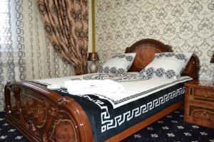 Кровать или кровати в номере Homehotel